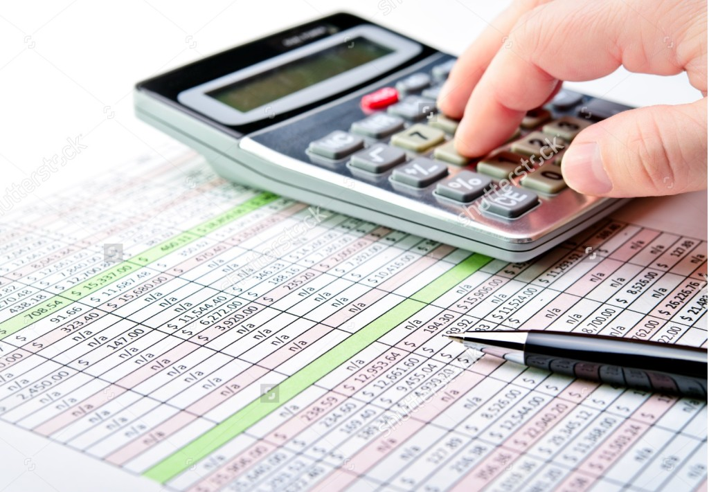 stock-photo-close-up-of-a-spreadsheet-with-pen-and-calculator-124697734